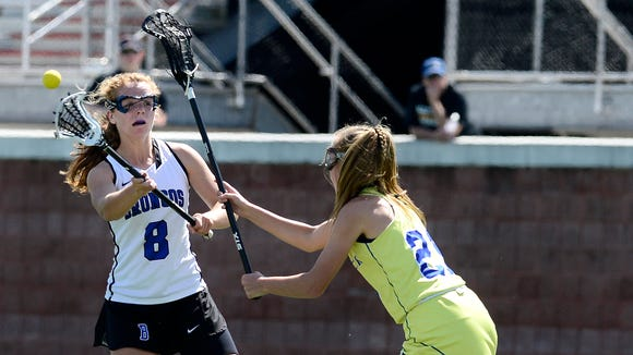 Bronxville's Ellie Walsh, left, passes the ball while