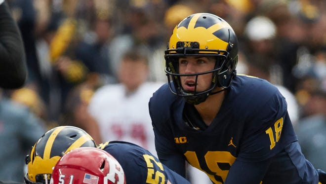 Brandon Peters prepares for the snap in the first half against Rutgers on Oct. 28.