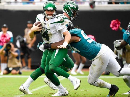 Oct 27, 2019; Jacksonville, FL, USA; Jacksonville Jaguars defensive end Dawuane Smoot (94) sacks New York Jets quarterback Sam Darnold (14) during the second quarter at TIAA Bank Field. Mandatory Credit: Douglas DeFelice-USA TODAY Sports