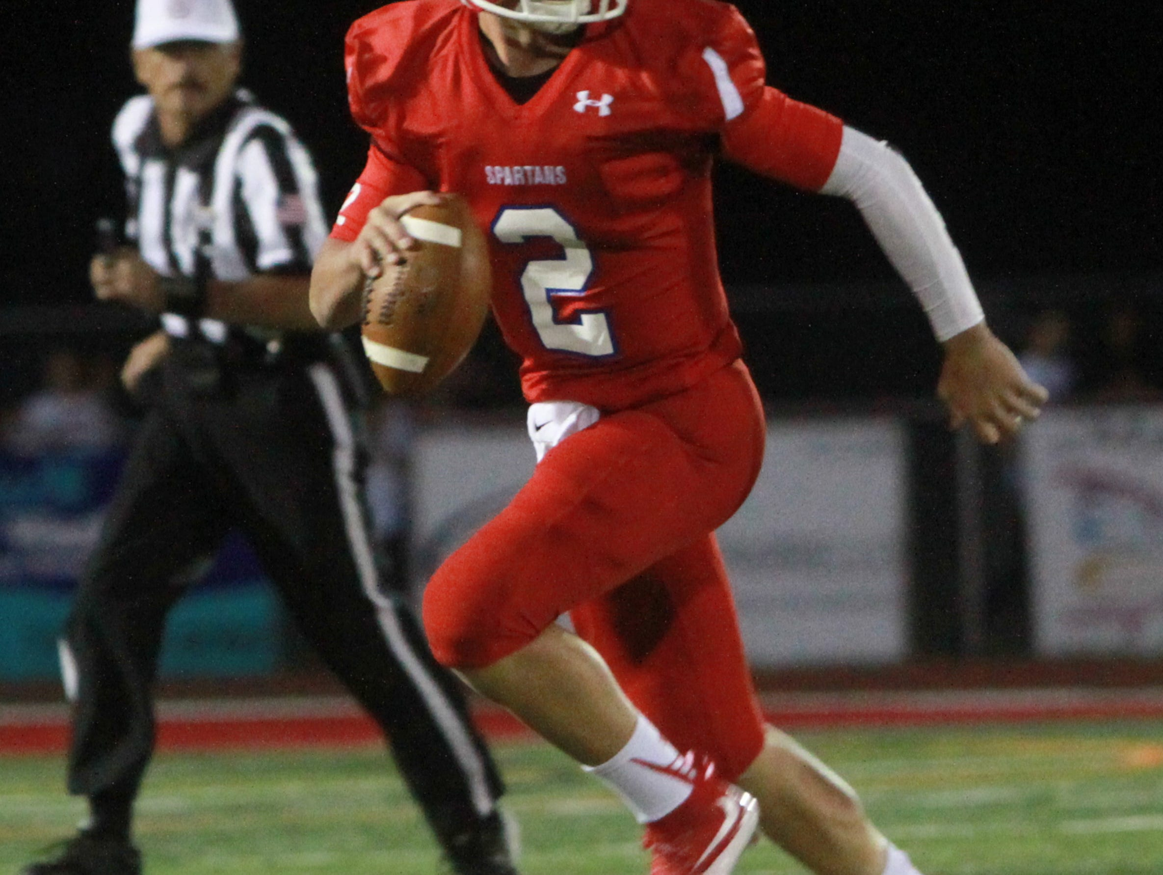 Ocean, NJ Red Bank at Ocean Friday night football. Ocean's QB #2 Kenny Pickett carries the ball in the first quarter. 092415