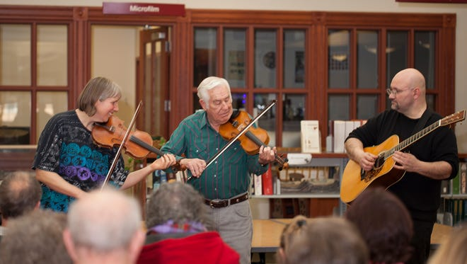 Musician Kenny Sidle plays his fiddle at the Licking County Library, in Newark, in 2015.