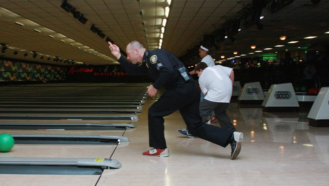 Sgt. Jeff Case bowls along with 35 middle schoolers at Nottke's Bowling Alley in Battle Creek Saturday afternoon