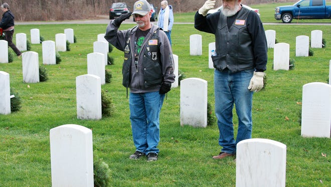 Jerry Cook and Lee Esterline of the Air Force American Legion Riders of Battle Creek gave their respect as they layed wreaths on the graves at Fort Custer National Cemetery Saturday afternoon