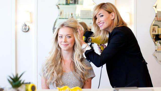 Drybar co-founder Alli Webb working with client.