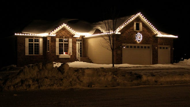 Holiday roofline lighting by Emerald Companies Inc.