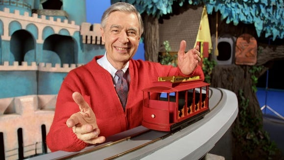 "Fred (Mr.) Rogers on the set of ""Mister Rogers' Neighborhood."""
