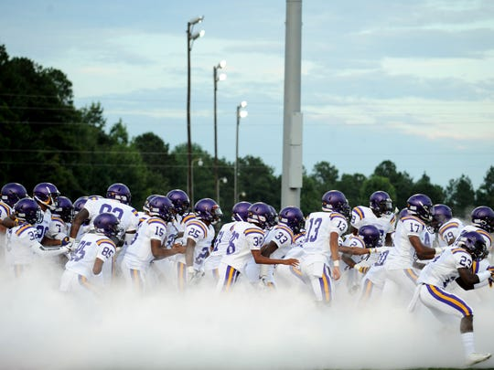 Hattiesburg High players enter the field in a game