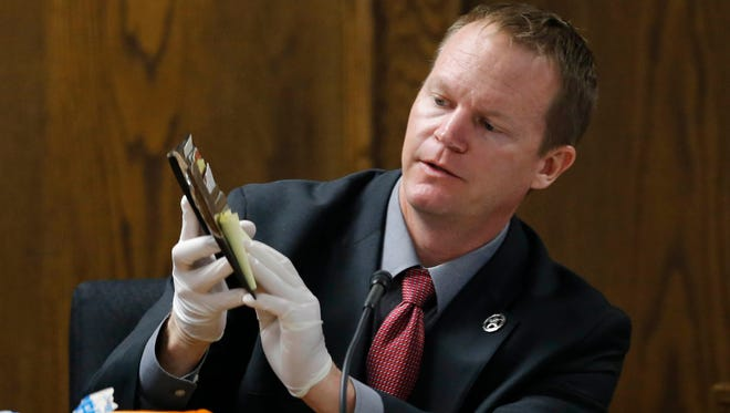 Texas Ranger Danny Briley identifies Eddie Ray Routh's wallet Feb. 16, 2015, during the capital murder trial of former Marine Cpl. Routh at Erath County's Donald R. Jones Justice Center in Stephenville, Texas.