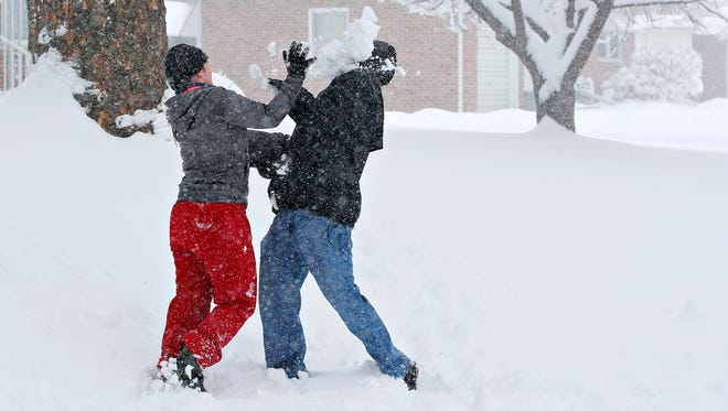 Samantha and Kevin Eck playfully battle through a snowball fight as snow continues to fall through Winter Storm Toby on the second day of spring in Springettsbury Township, Wednesday, March 21, 2018. Dawn J. Sagert photo
