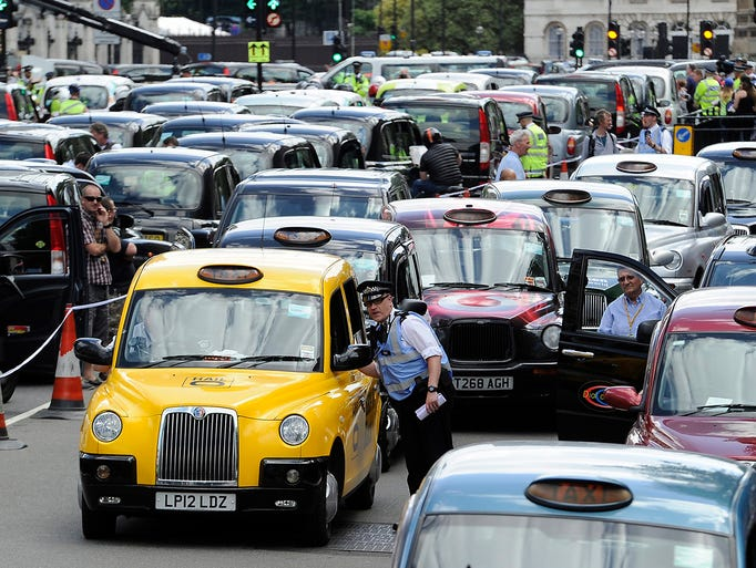 Taxi drivers block roads around Whitehall during a June 11 protest against vehicle-share mobile phone apps in London. Traffic in several European cities was severely disrupted as thousands of taxi drivers blocked roads to protest apps like Uber. The taxi industry claims Uber acts like a taxi service without incurring the costs of a license.