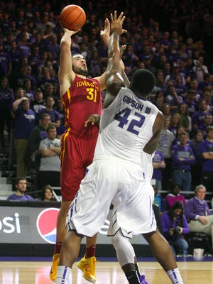 Iowa State Cyclones forward Georges Niang (31) shoots over Kansas State Wildcats forward Thomas Gipson (42) during first-half action at Fred Bramlage Coliseum.
