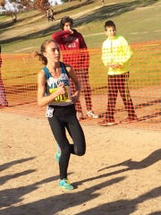 Claudia Lane of Malibu passes the one-mile mark en route to winning the CIF Division IV state cross country championship.