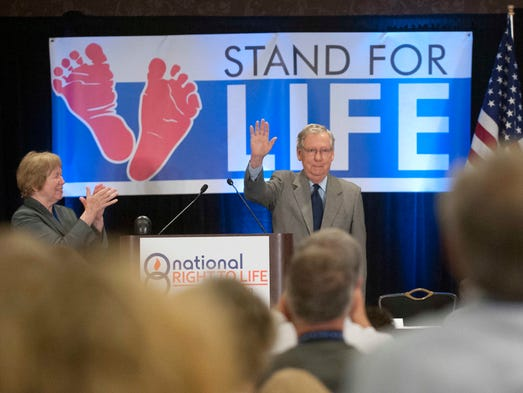 Darla St. Martin, Associate Executive Director of the National Right to Life Committee applauds Kentucky US Senator Mitch McConnell at the National Right To Life convention in Louisville, Ky. 28 June 2014