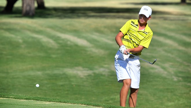 Zach Slayton chips onto the green at No. 5 Wednesday afternoon during the final round of the 62nd Annual Texas-Oklahoma Junior Golf Tournament at Wichita Falls Country Club.