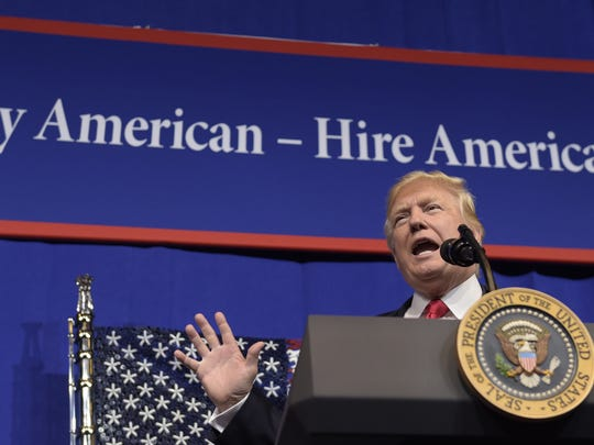 """President Donald Trump signed an executive order to study the government's """"Buy American"""" policy Tuesday at tool manufacturer Snap-on Inc. in Kenosha, Wisconsin."""