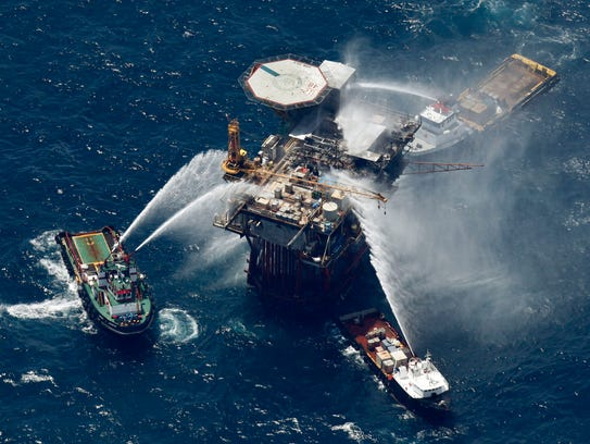 In this file photo taken Sept. 2, 2010, boats are seen spraying water on an oil and gas platform that exploded in the Gulf of Mexico, off the coast of Louisiana. All 13 crew members were rescued. The moratorium on offshore drilling and exploration in the eastern Gulf established in 2006 will expire in 2022 unless Congress acts.