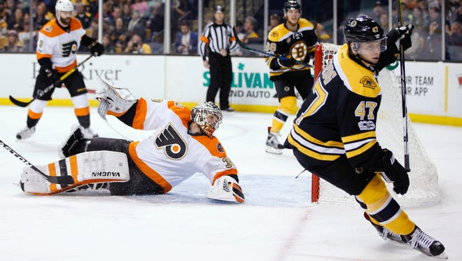 Torey Krug and the Boston Bruins lit the Flyers up for six goals Saturday.
