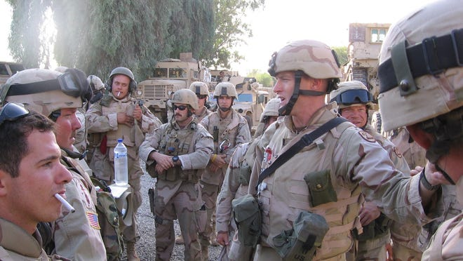 In this 2005 photo, Iowa National Guard 1st Lt. Andrew Hoenig gives a final briefing Monday at Camp Blue Diamond in Iraq before leaving on a mission. The Iowans are based at Camp Ramadi.