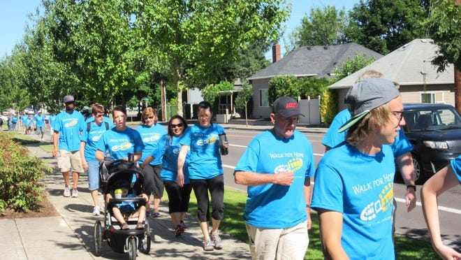Participants walk in the Union Gospel Mission of Salem Walk for Hope fundraising event on June 20.