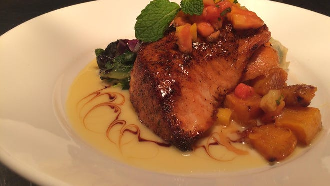 Grandma Tiny's Blackened Salmon is a Hot Dish from Yabba Island Grill in Naples.