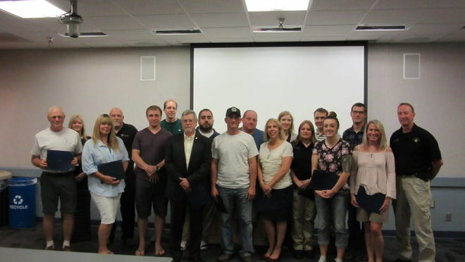 The 34th graduating class of the Salem Citizens Police Academy, pictured at the academy graduation on July 8.