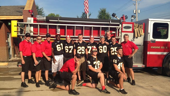 Hendersonville firefighters and members of the Hendersonville High School football team handed out and installed smoke detectors on Saturday, July 25. They were (L-R, back) firefighers David Osborne and Keith Binkley, HFD Capt. Gabe Hannah, HHS football players Alex Tate, Dustin Perdue, Jacob Eicher, Joe Phillips, Matt Shinault, Eric Tilson, and Jordan Amis, HFD Capt. Darrell Chance, (L-R, front) senior firefighter David Osborne and Commandos Sam Laws and Austin Winter.