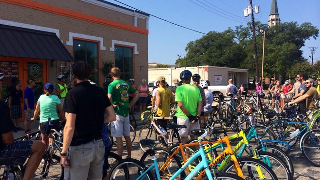 Bicyclists line up before a Slow Ride departs from Ride More Bicycles shop on East Gregory Street. The July Slow Ride is scheduled for Friday.