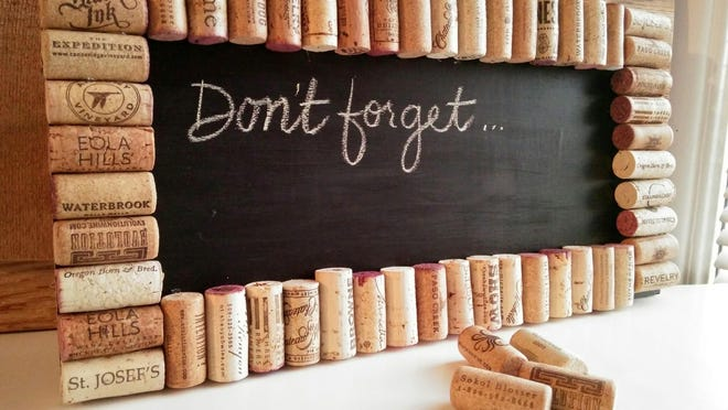Create a chalkboard with a few basic supplies and embellish it with corks from your favorite wines.