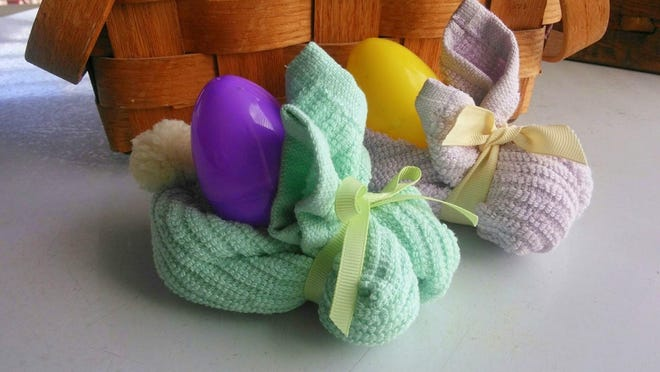 Crafty or not, just about anyone can fold a washcloth into a bunny to hold treats or bath fizzies.