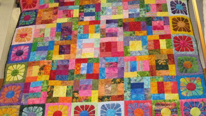 "This spring/summer colors quilt created by members of the Door County Quilters Guild was part of a previous ""Quilts Around the Library"" event at the Sturgeon Bay branch of the Door County Library. This year's quilt event takes place April 12."
