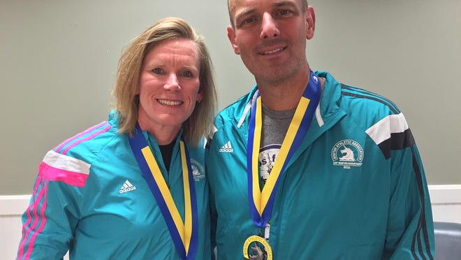 Kory and Robert Skrob with their medals following Monday's Boston Marathon.