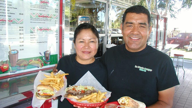 Genaro and Celi Martinez are owners of La Fiesta Burgers. Popular among the meals are, from left, the cheeseburger combo at $6.95, tri-tip sandwich combo at $10.50 and chorizo and potato burrito at $5.79.