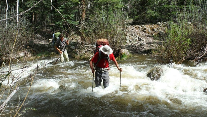 Members of the Dusty Nomads cross the Gila River in New Mexico.