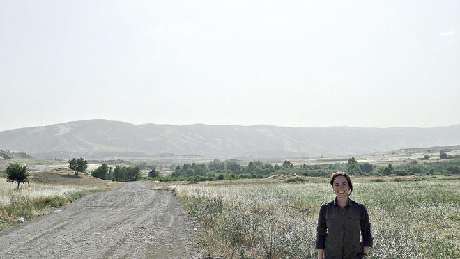 RIT professor Andrea Hickerson recently traveled to Iraqi Kurdistan with Christian Peacemaker Teams. She is pictured along the way from Dohuk to Irbil to Suleimania.