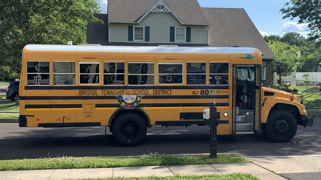 FILE: A Bristol Township School District bus decorated in honor of the Class of 2020 at Harry S Truman High School makes stops at the homes of Truman seniors Friday so that staff members could distribute gift bags to them.