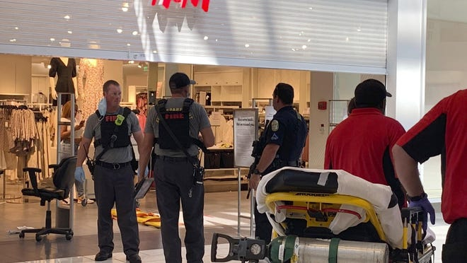 Authorities investigate a shooting July 3 at Riverchase Galleria shopping mall in Hoover that left an 8-year-old boy dead and three other people hospitalized.