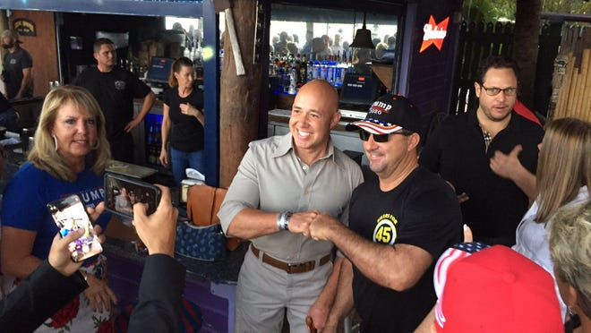 Congressman Brian Mast, R-Palm City, attends the reception for the Republican Party of Florida at the Square Grouper Tiki Bar in Jupiter Saturday. The reception followed the state GOP's annual meeting in Jupiter.