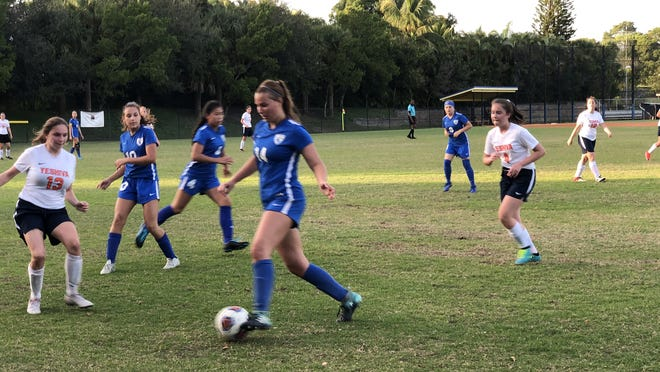 In this 2019 photo, Angelina Adolphy dribbles against Yeshiva. Thursday, Adolphy scored a goal as Lake Worth Christian girls soccer won a district championship.