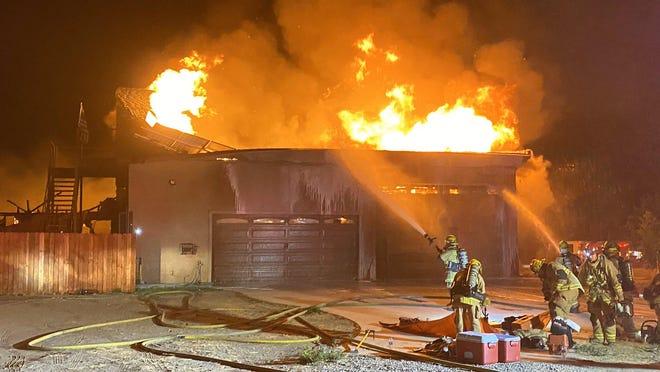 San Bernardino County Fire Department personnel battled a structure fire in the 14400 block of Azalea Road in Phelan late Sunday night.