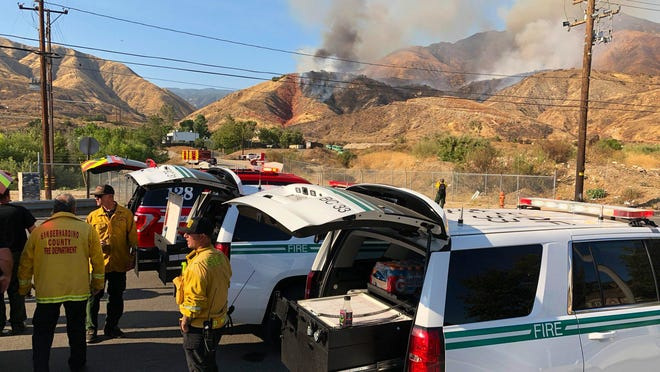 San Bernardino County Fire Department and San Bernardino National Forest personnel were in unified command of a wildfire that quickly burned at least 50 acres near Highland on Monday.