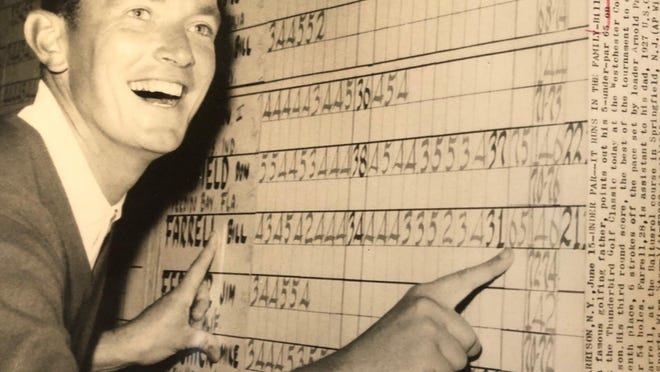 A young Billy Farrell points to a scoresheet for a mid-1960s Thunderbird Classic competition that was played at Westchester Country Club.