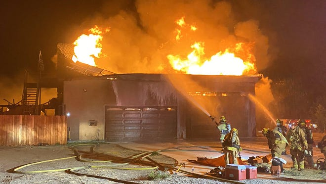 San Bernardino County Fire Department personnel battled a structure fire in the 14400 block of Azalea Road in Phelan late Sunday night.