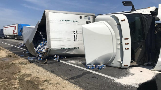 Interstate 70 reopened after 4 p.m. on Saturday after a semi-truck transporting Milwaukee's Best, an American-style pale lager, rolled over and shut down traffic for nearly two miles on Saturday morning.