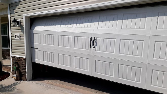 Hubert native Molly Johnson's garage door after tremors from an earthquake in Sparta, NC reached Eastern North Carolina.
