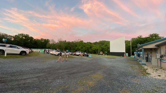 Cars line the parking area at Becky's Drive-In in Walnutport before the movie begins.