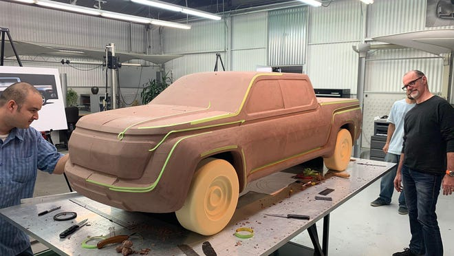 Lordstown Motors engineers work on designing clay models of the all-electric Endurance pickup.