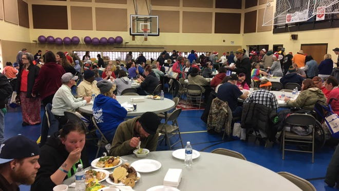 Share the Warmth, an annual Christmas dinner and giveaway, is canceled for 2020 due to the pandemic. Last year's event drew more than 500 people.  Photo courtesy of Michelle Beyer