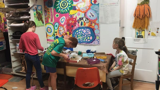 Children work on art projects at Paper Moon Art Studio in Clintonville, which closed in May after 5 years in business.