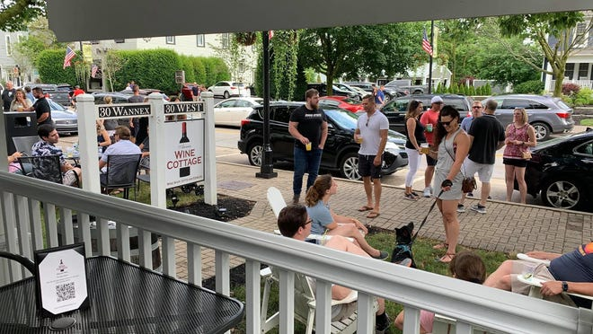 Visitors outside Annie's Wine Cottage in Powell last weekend were able to make use of the city's first Designated Outdoor Refreshment Area.