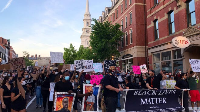 A large crowd gathered in Portsmouth's Market Square for a Black Lives Matter vigil in repsonse to the killing of George Floyd on Thursday, June 5.